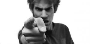 angry aggressive teen pointing finger illustrating Bible story of the rebellious child