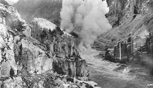 Near Hope, BC: Fraser River passage at Hell's Gate, British Columbia, being blasted open after an avalanche.