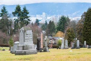 Mountain View Cemetery, Vancouver, surrounded by neighborhood, city, and mountains, where death is integrated into the life of the community. Photo by Jason Payne, Vancouver Sun.