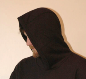 Man with face obscured by a hoodie illustrating a post on anonymous