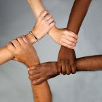 Social values of Leviticus illustrated by a circle of 5 hands, belong to people male and female, black and white.