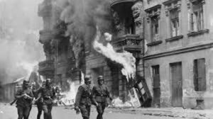 Warsaw Ghetto burning, illustrating a post about the concept of spiritual trial in the Lord's Prayer